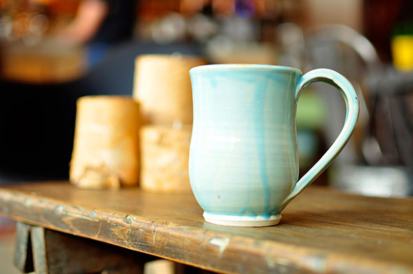 a finished ceramic mug sites on a table