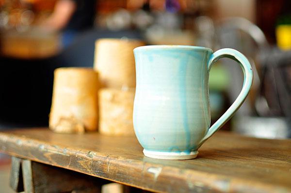 a finished ceramic mug sites on a table