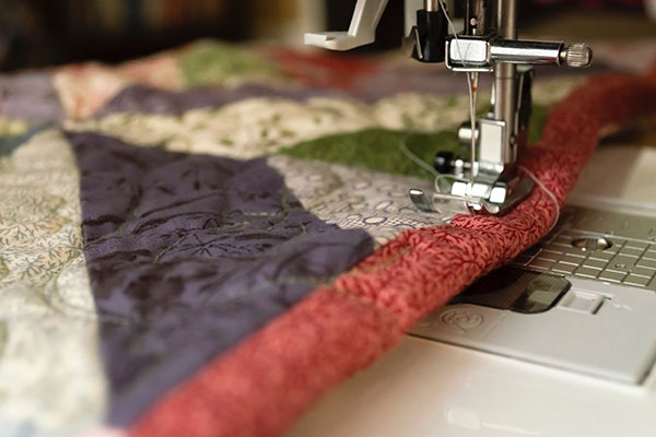 closeup of a quilt in a sewing machine